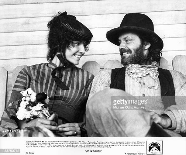 Mary Steenburgen and Jack Nicholson smiling as they sit together in a scene from the film 'Goin' South' 1978