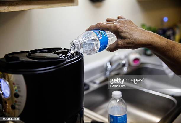 Mary Stewart pours bottled water to make coffee in her apartment on the north side on January 21 2016 in Flint Michigan She said that when the...
