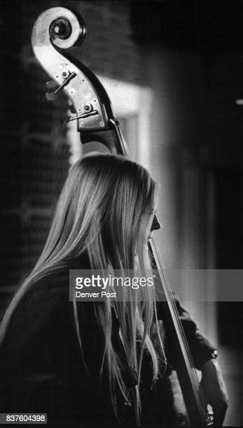 Mary Stribling a member of the City Limits bluegrass band plays bass during a recent recording session at Denver's Biscuit City Records apartment...