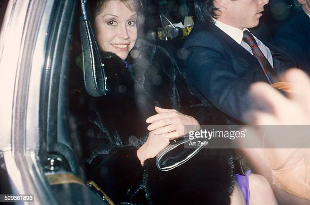 Mary Tyler Moore wearing a fur in a limousine circa 1970 New York