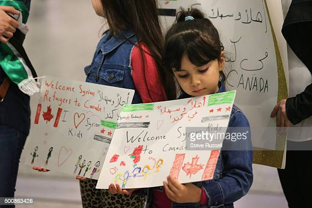 Maryam and Nore Kasmeih wait for Syrian refugees at the airport their mother came to Canada 15 years ago and their family that was in Syria has fled...