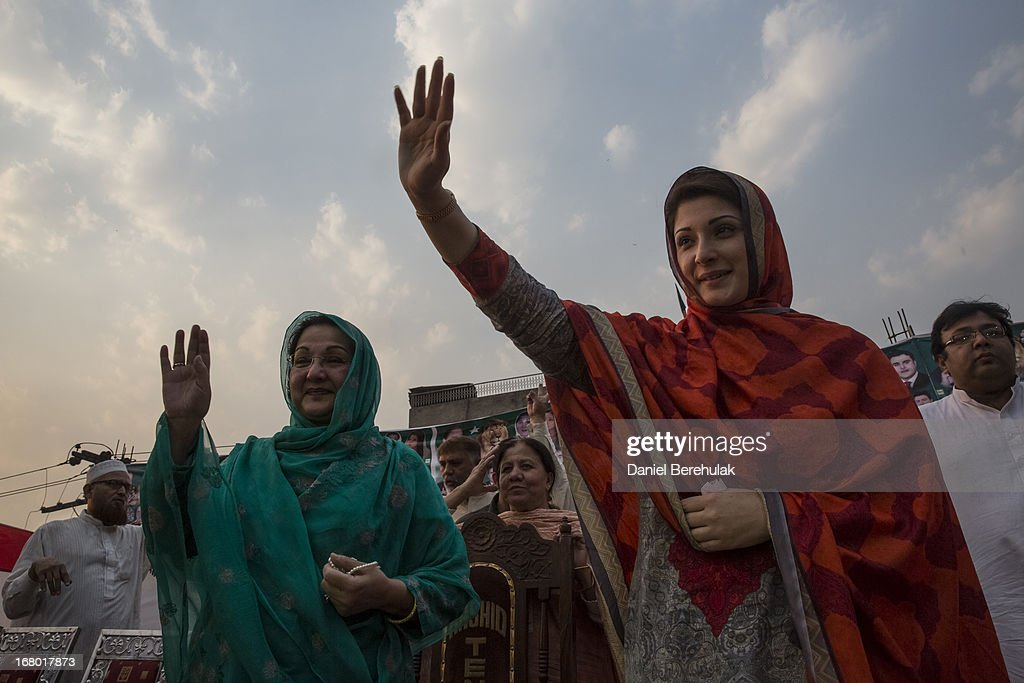 Maryam Nawaz Sharif, daughter of former Prime minister Nawaz Sharif, and her mother Kalsoom Nawaz Sharif, of political party Pakistan Muslim League-N (PMLN), wave to supporters during an election campaign rally on May 04, 2013 in Lahore, Pakistan. Pakistan's parliamentary elections are due to be held on May 11. Imran Khan of Pakistan Tehrik e Insaf (PTI) and Nawaz Sharif of the Pakistan Muslim League-N (PMLN) have been campaigning hard in the last weeks before polling.