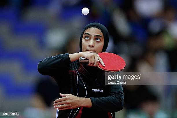 Maryam S B A Abdulraheem of Kuwait competing against Kim Jong of North Korea in Table Tennis Women's Team Preliminary Round Group D during day eight...