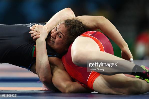 Maryia Mamashuk of Belarus competes against Elena Sergey Pirozhkova of the United States during the Women's Freestyle 63 kg Semifinals match on Day...