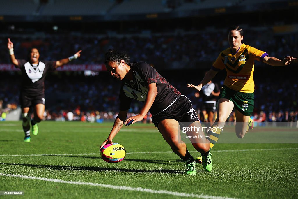 Mary-Jane Ale of the New Zealand Kiwi Ferns dives over to score a try during the international women's rugby league test match between the New Zealand Ferns and the Australian Jillaroos at Eden Park on February 7, 2016 in Auckland, New Zealand.