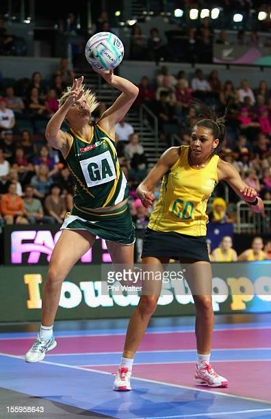 Maryka Holtzhausen of South Africa and Chanel Gomes of Australia contest the ball in the match between Australia and South Africa during day two of...
