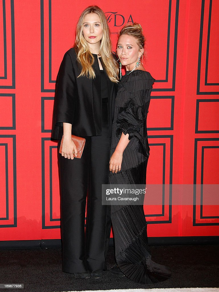 MaryKate and <a gi-track='captionPersonalityLinkClicked' href=/galleries/search?phrase=Elizabeth+Olsen&family=editorial&specificpeople=5775031 ng-click='$event.stopPropagation()'>Elizabeth Olsen</a> attend the 2013 CFDA Fashion Awards on June 3, 2013 in New York, United States.