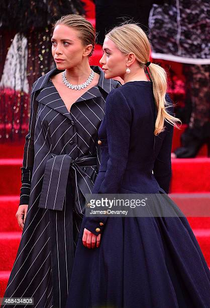 MaryKate Olsen and Ashley Olsen attend the 'Charles James Beyond Fashion' Costume Institute Gala at the Metropolitan Museum of Art on May 5 2014 in...
