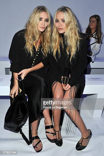 MaryKate Olsen and Ashley Olsen attend the Dw by Kanye West Ready to Wear Spring / Summer 2012 show during Paris Fashion Week at Lycee Henri IV on...