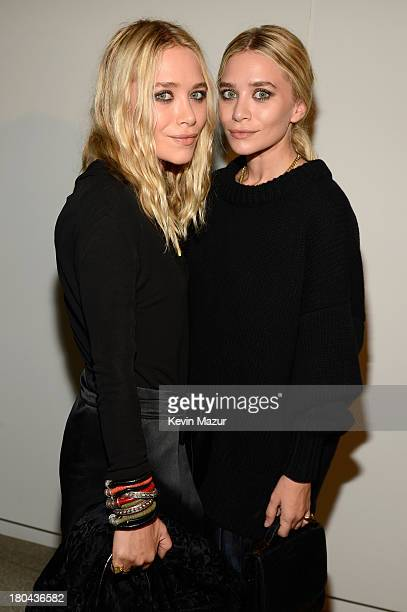 MaryKate Olsen and Ashley Olsen attend the Estee Lauder 'Modern Muse' Fragrance Launch Party at the Guggenheim Museum on September 12 2013 in New...