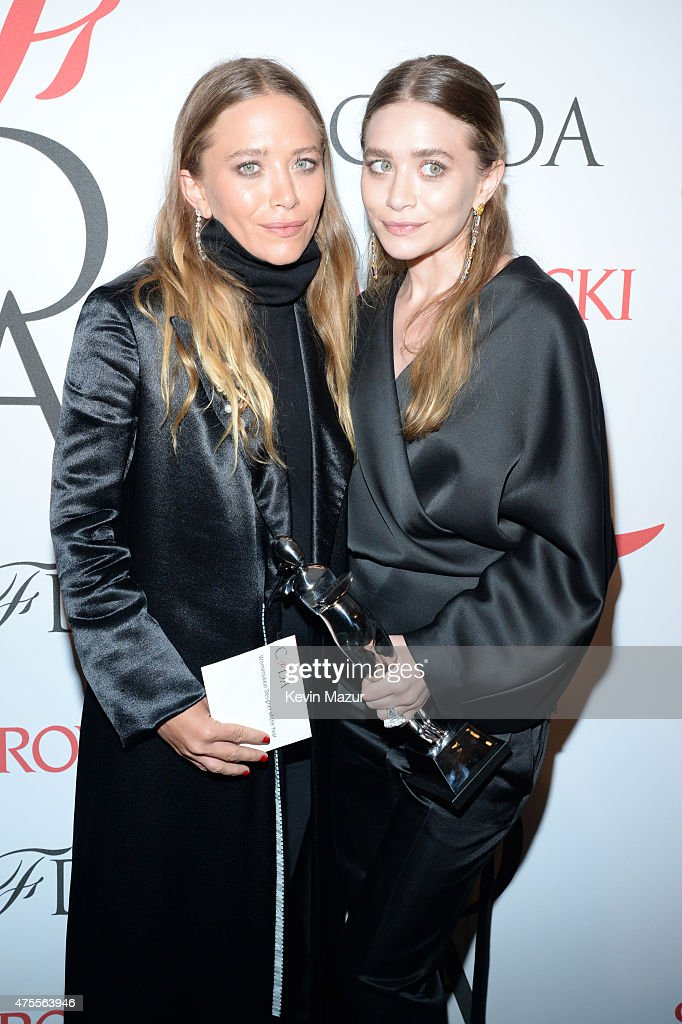 MaryKate Olsen and Ashley Olsen pose backstage at the 2015 CFDA Fashion Awards at Alice Tully Hall at Lincoln Center on June 1 2015 in New York City