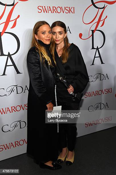 MaryKate Olsen and Ashley Olsen pose on the winners walk at the 2015 CFDA Fashion Awards at Alice Tully Hall at Lincoln Center on June 1 2015 in New...