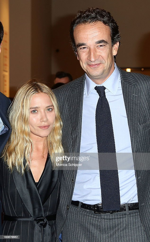 <a gi-track='captionPersonalityLinkClicked' href=/galleries/search?phrase=Mary-Kate+Olsen&family=editorial&specificpeople=156430 ng-click='$event.stopPropagation()'>Mary-Kate Olsen</a> and <a gi-track='captionPersonalityLinkClicked' href=/galleries/search?phrase=Olivier+Sarkozy&family=editorial&specificpeople=5577808 ng-click='$event.stopPropagation()'>Olivier Sarkozy</a> attend 2013 'Take Home A Nude' Benefit Art Auction And Party at Sotheby's on October 8, 2013 in New York City.