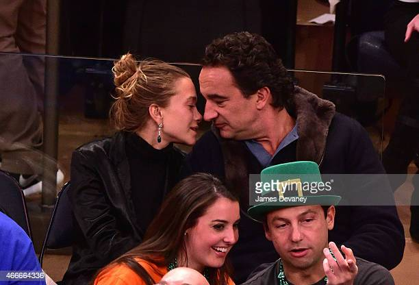 MaryKate Olsen and Olivier Sarkozy attend San Antonio Spurs vs New York Knicks game at Madison Square Garden on March 17 2015 in New York City