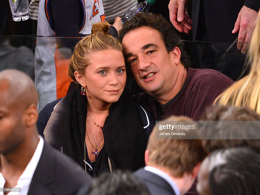 <a gi-track='captionPersonalityLinkClicked' href=/galleries/search?phrase=Mary-Kate+Olsen&family=editorial&specificpeople=156430 ng-click='$event.stopPropagation()'>Mary-Kate Olsen</a> and <a gi-track='captionPersonalityLinkClicked' href=/galleries/search?phrase=Olivier+Sarkozy&family=editorial&specificpeople=5577808 ng-click='$event.stopPropagation()'>Olivier Sarkozy</a> attend the Dallas Mavericks vs New York Knicks game at Madison Square Garden on November 9, 2012 in New York City.