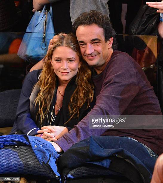 MaryKate Olsen and Olivier Sarkozy attend the Dallas Mavericks vs New York Knicks game at Madison Square Garden on November 9 2012 in New York City