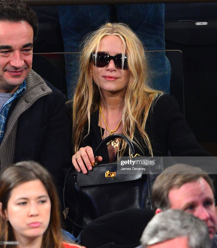 <a gi-track='captionPersonalityLinkClicked' href=/galleries/search?phrase=Mary-Kate+Olsen&family=editorial&specificpeople=156430 ng-click='$event.stopPropagation()'>Mary-Kate Olsen</a> attends the Los Angeles Lakers vs New York Knicks game at Madison Square Garden on December 13, 2012 in New York City.