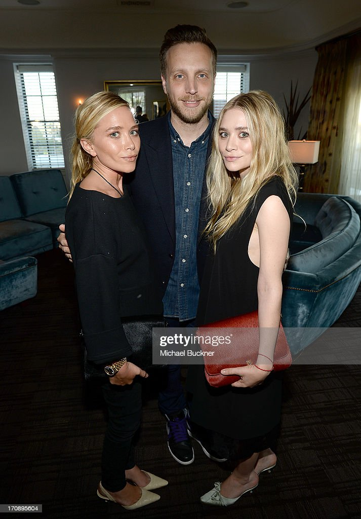 Mary-Kate Olsen, InStyle Editor Ariel Foxman, and Ashley Olsen attend Mary-Kate Olsen, Ashley Olsen, and InStyle Editor Ariel Foxman celebrate the launch of the Elizabeth and James Fall 2013 Handbag Collection at a cocktail party held at Chateau Marmont in West Hollywood on June 19, 2013.