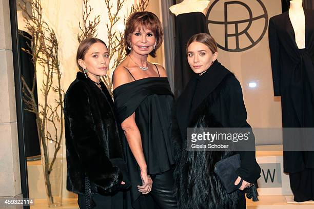 MaryKate Olsen Marion Heinrich and Ashley Olsen pose during the presentation of their collection 'The Row' at Marion Heinrich on November 20 2014 in...