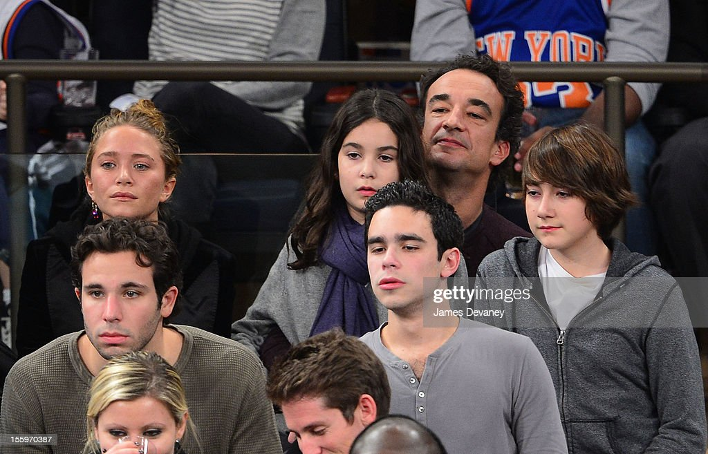 Mary-Kate Olsen, Olivier Sarkozy and his children attend the Dallas Mavericks vs New York Knicks game at Madison Square Garden on November 9, 2012 in New York City.