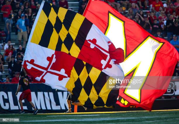 Maryland banners paraded along the touchline after a touchdown during a college football game between the Maryland Terrapins and the Northwestern...
