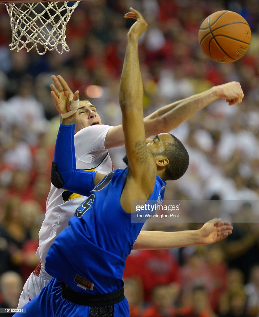 Maryland center Alex Len (25), left, rejects the shot of Duke forward Josh Hairston (15) as Duke plays the University of Maryland in NCAA mens basketball at the Comcast Center in College Park MD, February 16, 2012 .