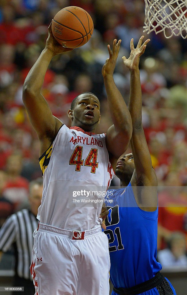 Maryland center Shaquille Cleare (44), left, scores a basket against Duke forward Amile Jefferson (21) as the University of Maryland defeats Duke 83 - 81in NCAA mens basketball at the Comcast Center in College Park MD, February 16, 2012 .