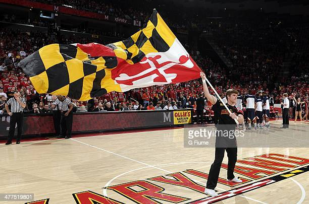 Maryland cheerleader waves the flag before the game between the Maryland Terrapins and the Virginia Cavaliers at the Comcast Center on March 9 2014...