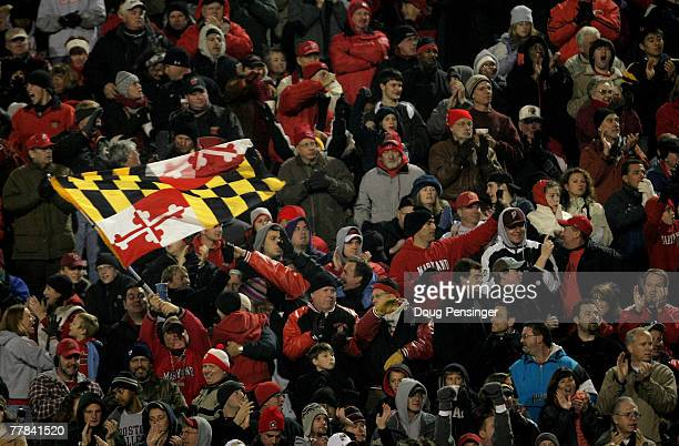 Maryland fan waves the state flag as the Boston College Eagles square off against the Maryland Terrapins at Byrd Stadium on November 10 2007 in...