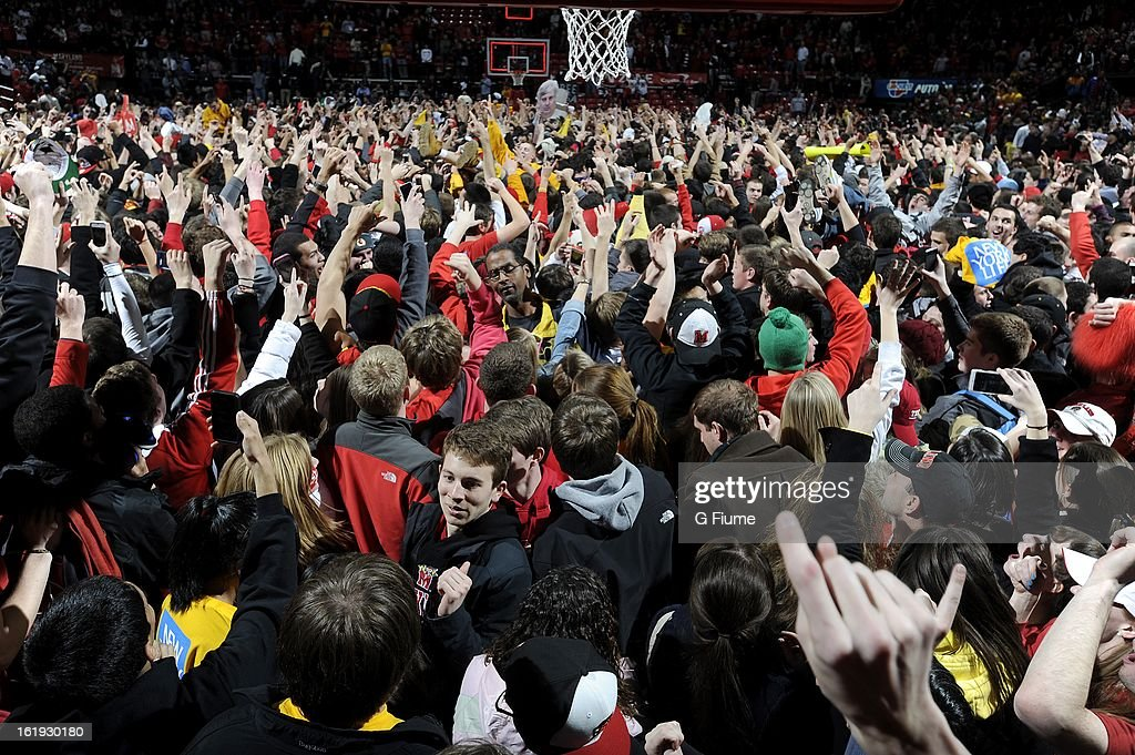Maryland fans storm the court after the Maryland Terrapins beat the Duke Blue Devils 83-81 at the Comcast Center on February 16, 2013 in College Park, Maryland.