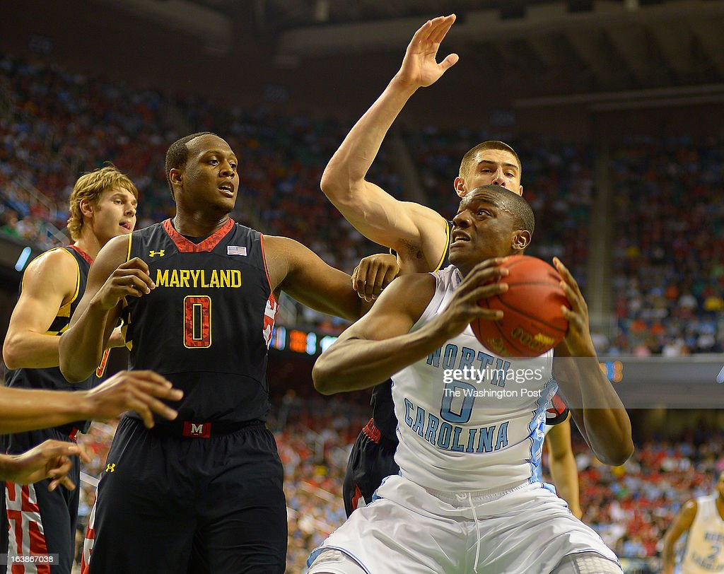 Maryland forward Charles Mitchell (0) , center, defends against North Carolina forward Joel James (0) going for a shot as the North Carolina Tar Heals play the Maryland Terrapins in the ACC mens basketball semifinal at the Greensboro Coliseum in Greensboro NC, March 16, 2013.