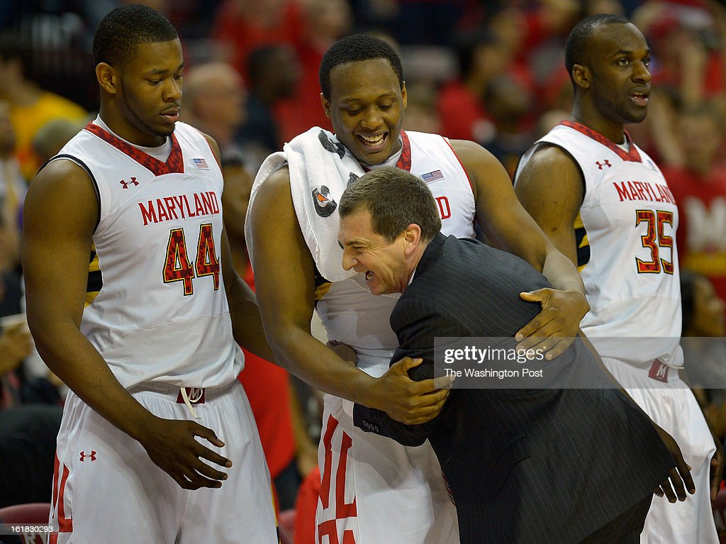 Maryland forward Charles Mitchell (0), center, left, receives a hug from Maryland's head coach Mark Turgeon during a play late in the 2nd half as Maryland widen it's lead as the University of Maryland defeats Duke 83 - 81in NCAA mens basketball at the Comcast Center in College Park MD, February 16, 2012 .