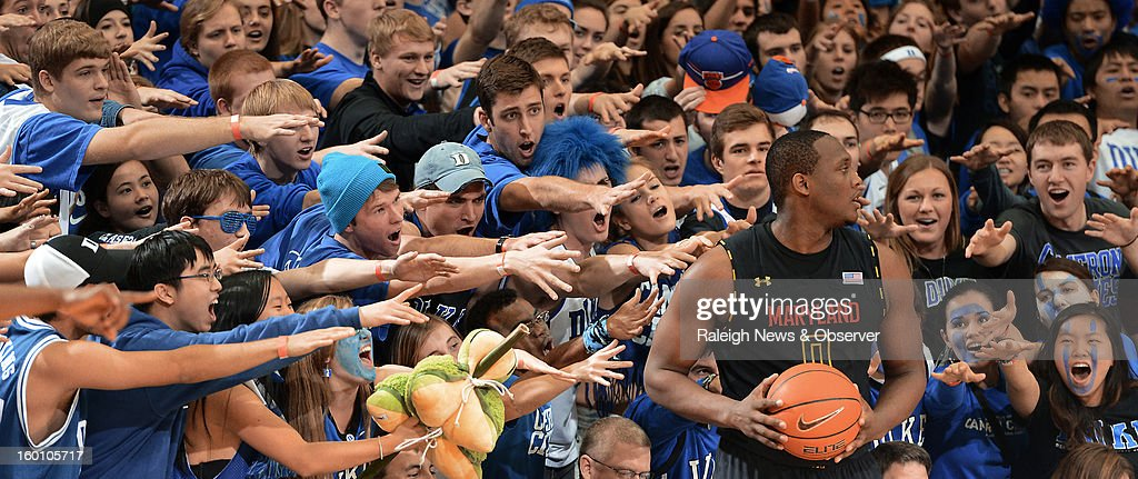 Maryland forward Charles Mitchell (0) is greeted by the Crazies as he inbounds the ball in the second half against Duke at Cameron Indoor Stadium in Durham, North Carolina, Saturday, January 26, 2013. Duke defeated Maryland, 84-64.