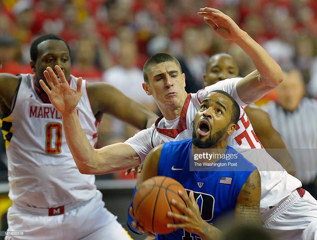 Maryland forward Charles Mitchell (0), left, and Maryland center Alex Len (25), center, put defensive pressure onDuke forward Josh Hairston (15) as the University of Maryland defeats Duke 83 - 81in NCAA mens basketball at the Comcast Center in College Park MD, February 16, 2012 .