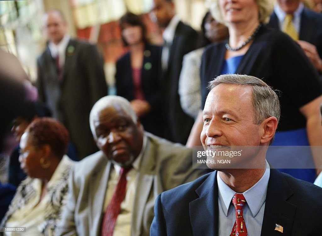 Maryland Governor Martin O'Malley is seated before remarks by US President Barack Obama following a tour of Ellicott Dredges on May 17, 2013 in Baltimore, Maryland. Obama is visiting Baltimore on what the administration called ' his second Middle Class Jobs and Opportunity Tour'. AFP PHOTO/Mandel NGAN