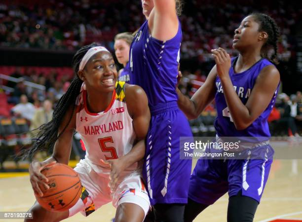 Maryland guard Kaila Charles left drives under the basket against Niagara forward Kaylee Stroemple center and Niagara guard Jai Moore during the...