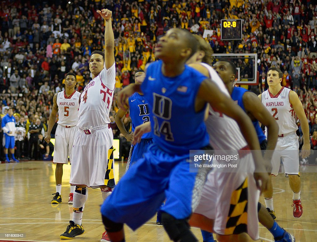 Maryland guard Seth Allen (4), center left, sinks his 2nd game winning free throw with 2.8 seconds left in the game as the University of Maryland defeats Duke 83 - 81in NCAA mens basketball at the Comcast Center in College Park MD, February 16, 2012 .