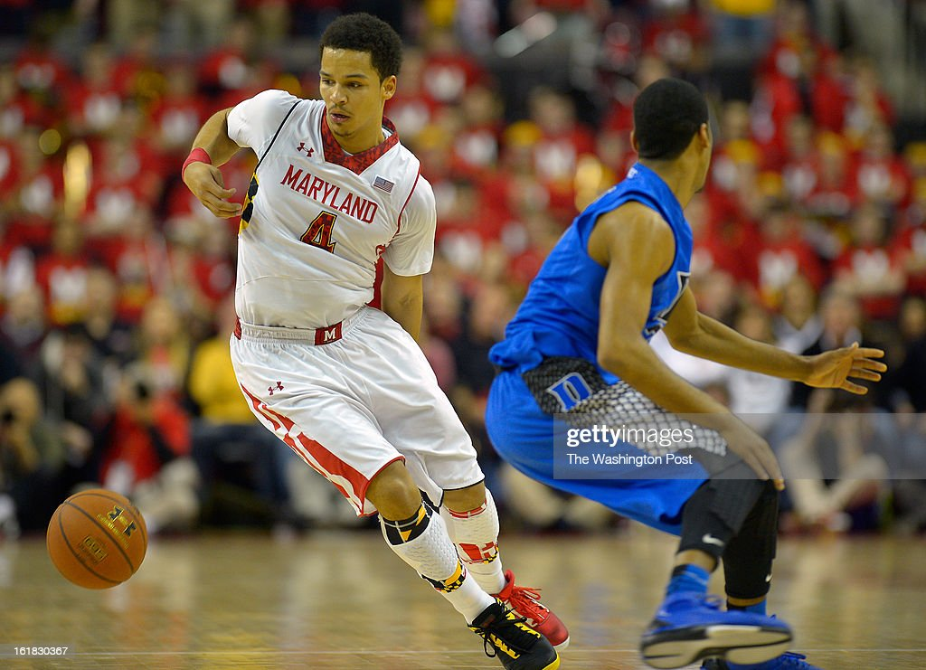 Maryland guard Seth Allen (4), left, dribbles behind the back against Duke guard Quinn Cook (2) as the University of Maryland defeats Duke 83 - 81in NCAA mens basketball at the Comcast Center in College Park MD, February 16, 2012 .