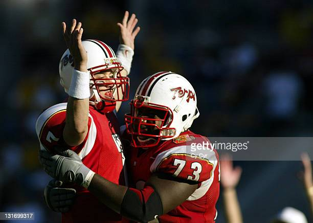 Maryland quarterback Scott McBrien gets a hug from Lamar Bryant #73 following a fourth quarter touchdown in the 2004 Gator Bowl at Alltel Stadium on...