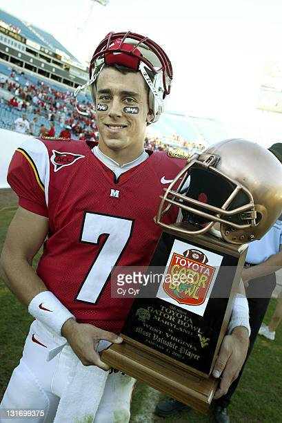 Maryland quarterback Scott McBrien poses with the MVP trophy after the 2004 Gator Bowl at Alltel Stadium on January 1st 2004 Maryland won by the...