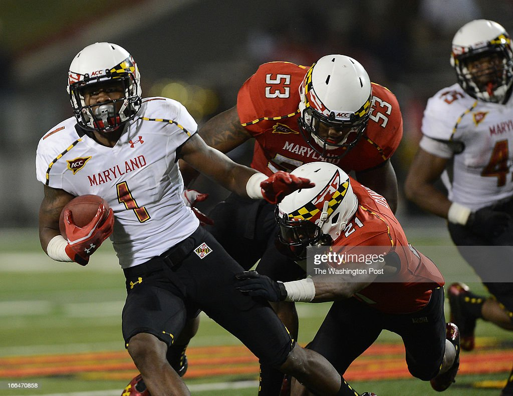 Maryland sophomore Stefon Diggs runs for a first down against the Red team during the Terrapins' spring football game at Byrd Stadium on Friday, April 12, 2013.
