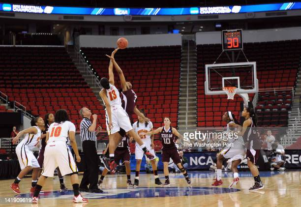 Maryland Terrapins center Alicia DeVaughn and Texas AampM Aggies center Kelsey Bone tip the ball to start a Regional Semifinal game of the Women's...