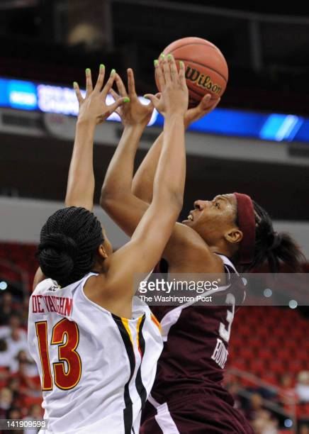 Maryland Terrapins center Alicia DeVaughn blocks the shot by Texas AampM Aggies center Kelsey Bone during a Regional Semifinal game of the Women's...