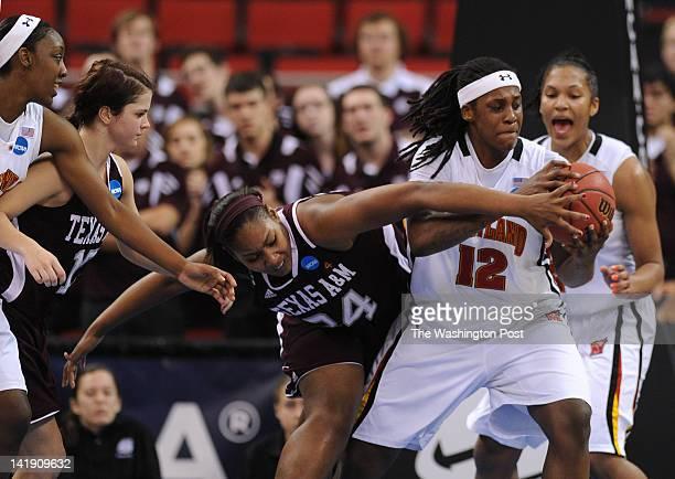 Maryland Terrapins center Lynetta Kizer right grabs the defensive rebound as Texas AampM Aggies center Karla Gilbert center left reaches in during a...