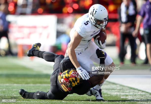 Maryland Terrapins defensive back Antoine Brooks brings down Northwestern Wildcats wide receiver Charlie Fessler during a college football game...