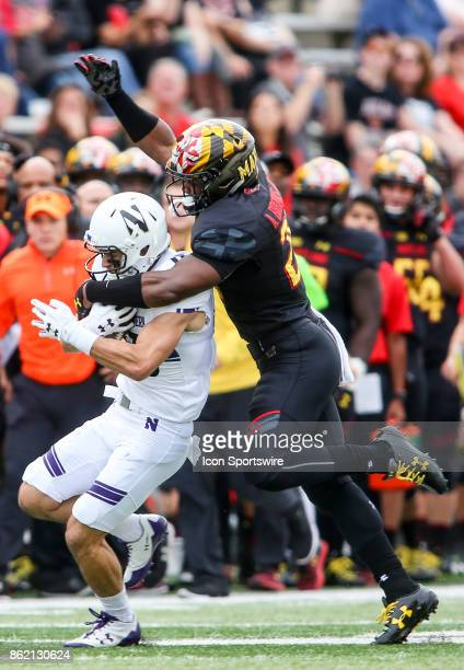 Maryland Terrapins defensive back Antoine Brooks pounces on Northwestern Wildcats wide receiver Macan Wilson during a college football game between...