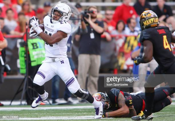 Maryland Terrapins defensive back Josh Woods misses a tackle on Northwestern Wildcats running back Justin Jackson during a college football game...