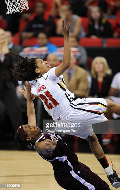 Maryland Terrapins forward Tianna Hawkins falls back towards Texas AampM Aggies center Kelsey Bone on her way to the ground during a Regional...