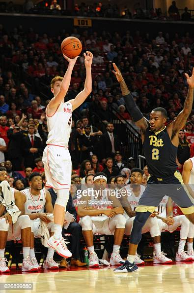 Maryland Terrapins guard Kevin Huerter shoots against Pittsburgh Panthers forward Michael Young on November 29 at Xfinity Center in College Park MD...
