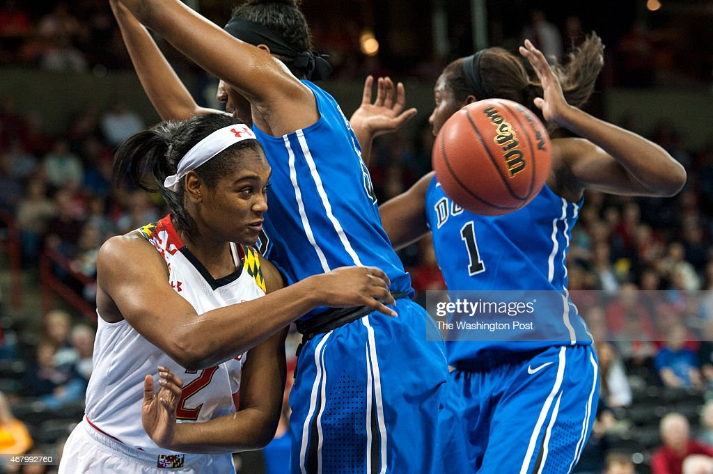 Maryland Terrapins guard Kiara Leslie passes around the Duke Blue Devils defense in the first half at Spokane Veterans Memorial Arena during the NCAA...